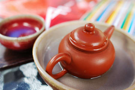 Closeup view of a pottery teapot with teacup  photo