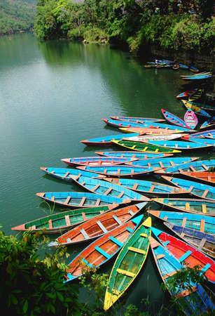 tour boats: Scenery of colorful tour boats at a lake