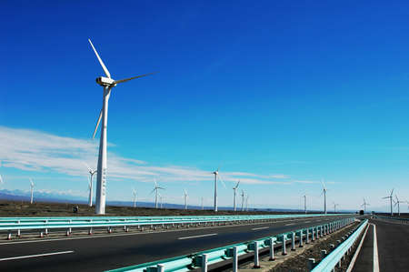 Wind turbine generators in sinkiang,china,with blue skies and white clouds as backgrounds photo