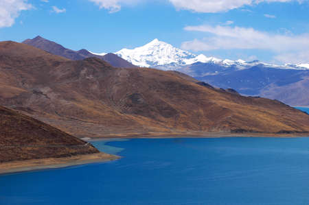 Landscape of snow mountains and blue lake in Tibet Stock Photo - 8576473