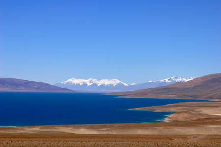Landscape of blue lake and snow covered mountains in the highlands of Tibet Stock Photo - 8724097