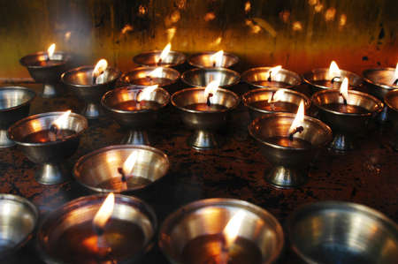 Burning yak butter lamps in a Tibetan lamasery photo