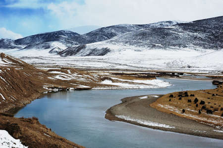 Landscape of mountains and river in winter photo