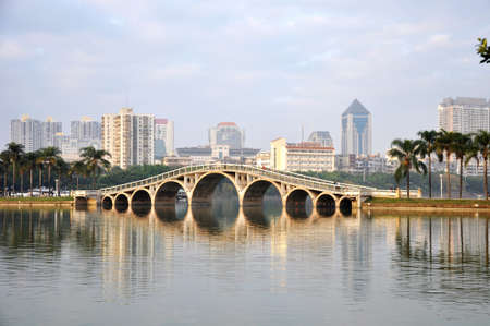 Landscape of ancient bridge over the river in the urban area photo