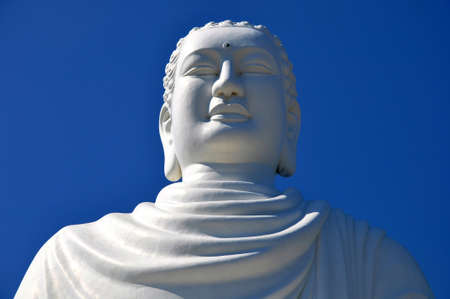 Closeup view of a historic buddha statue made of white marble against blue sky Stock Photo - 9451551