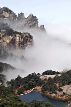 Landscape of mountains in the morning fogs Stock Photo