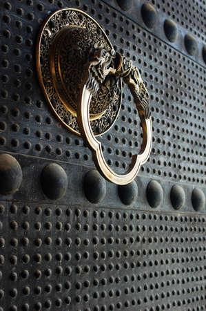 Ancient iron door with a copper doorknob Stock Photo - 9701411