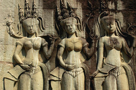 Ruins of ancient rock sculptures at Angkor, Cambodia photo