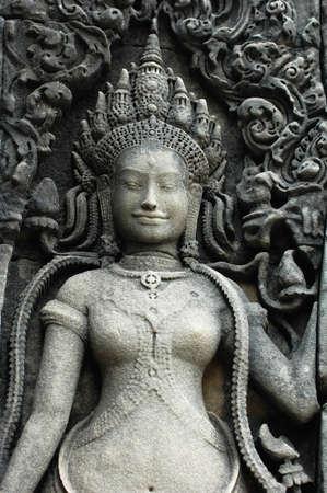hindu goddess: Rock sculpture of a smiling goddess at Angkor, Cambodia Stock Photo