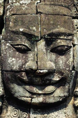 Ruins of giant smiling buddha statue at Angkor, Cambodia photo