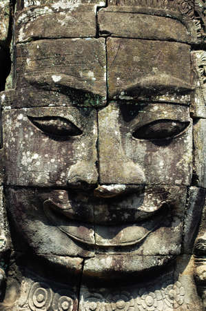 Ruins of giant smiling buddha statue at Angkor, Cambodia photo