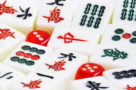 A pile of Chinese mahjong tiles with dices photo