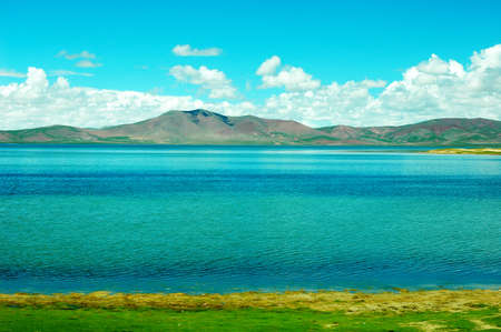 Landscape of green meadows and blue lakes in a sunny day Stock Photo - 9943747