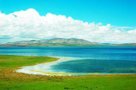 Landscape of green meadows and blue lakes in a sunny day Stock Photo - 9943746