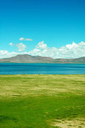 Landscape of green meadows and blue lakes in a sunny day Stock Photo - 9943745