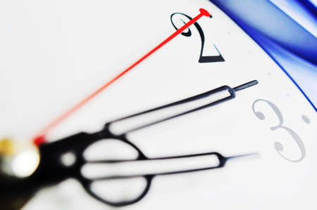 Closeup view of hour,minute and second hands of a wall clock, shallow DOF Stock Photo - 10054244