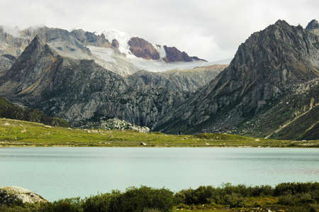 Landscape of snow-capped mountains and blue lake Stock Photo - 10054322