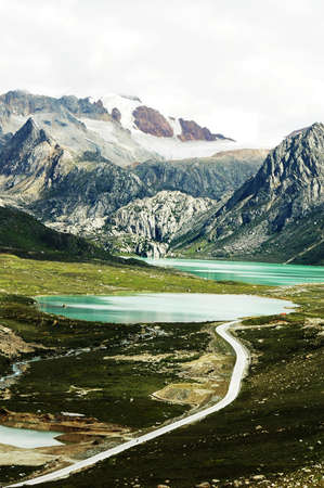 Landscape of snow-capped mountains and blue lake Stock Photo - 10054324