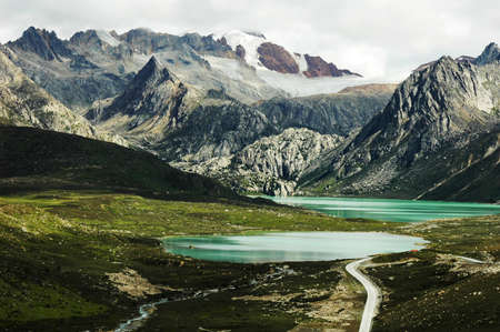 Landscape of snow-capped mountains and blue lake Stock Photo - 10054325