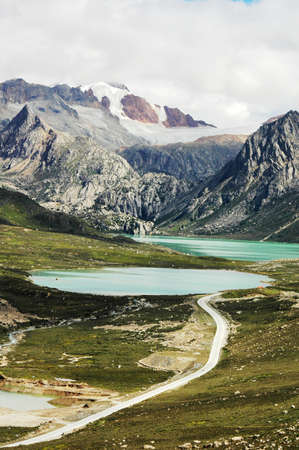 Landscape of snow-capped mountains and blue lake Stock Photo - 10054323