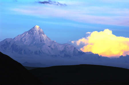 Landscape of snow-capped mountains of Gongga in Sichuan, China at sunset