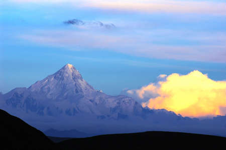 Landscape of snow-capped mountains of Gongga in Sichuan, China at sunset photo