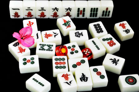 Chinese mahjong tiles and dices on a black background