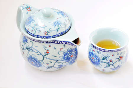 porcelain flower: Traditional Chinese teaset on a white background