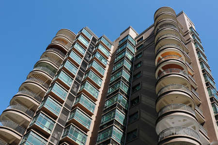 New high residential apartment block against blue sky Stock Photo - 10900425