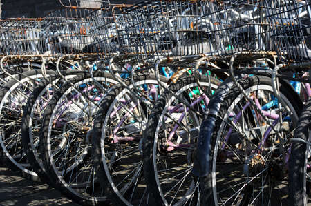 parked bicycles: Old bicycles parked in a row Stock Photo