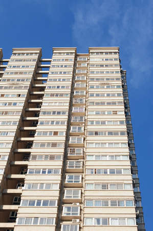 Bottom view of modern apartment buildings against blue sky Stock Photo - 11215094