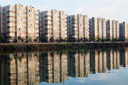 Apartment blocks with mirror by a lake