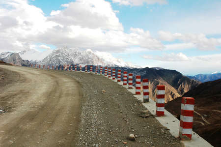 rough road: A rough mountain road in the highland of Tibet Stock Photo