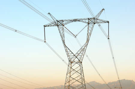 High voltage transmission lines with blue sky as background photo