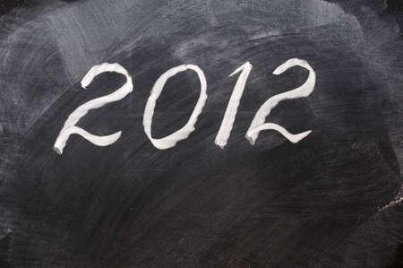 Handwriting of Year 2012 on a blackboard Stock Photo
