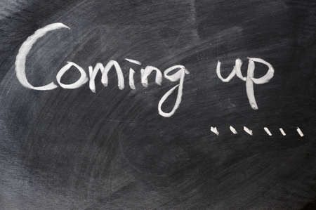 Coming up written on blackboard Stock Photo - 11690742