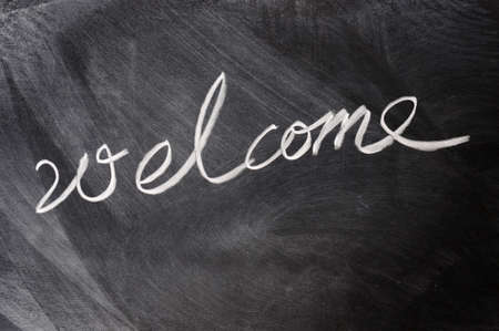 welcome sign: Welcome written on blackboard Stock Photo