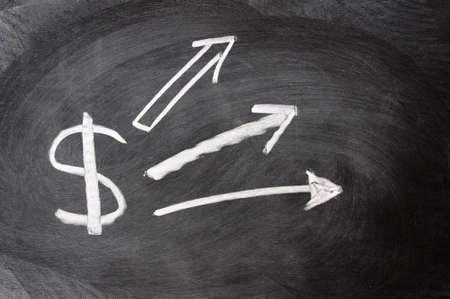 US Dollar sign with up arrows written on blackboard photo