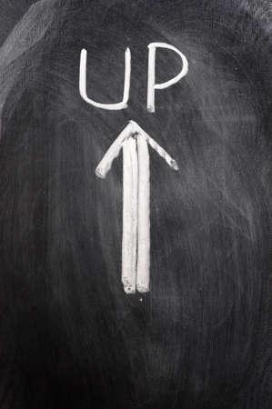 blankness: Up arrow written on blackboard