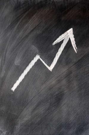 Rising up arrow written on a blackboard photo