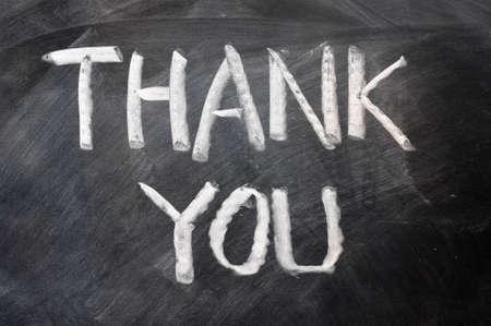dank u: Handschrift van Dank u wel op een schoolbord