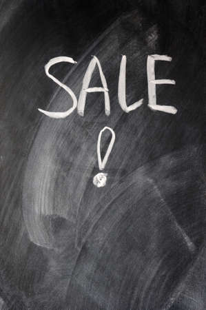 undersign: Sale written on blackboard with an exclamation mark