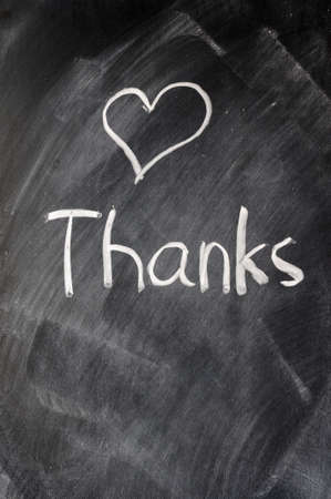 Handwriting of Thank you on a blackboard photo