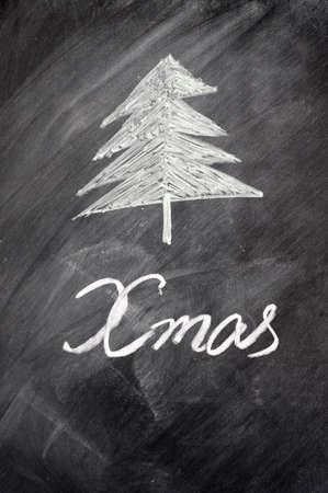 Christmas tree drawn on a blackboard photo