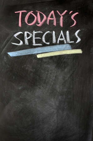 specials: Menu of todays specials written with chalk on a blackboard Stock Photo