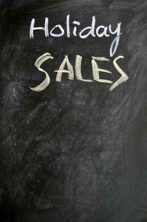 Holiday sales written with chalk on a blackboard Stock Photo - 11690795