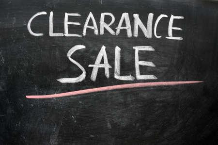 Clearance sale written with chalk on a blackboard