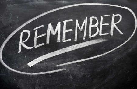 Remember word written with chalk on a blackboard Stock Photo - 11690799