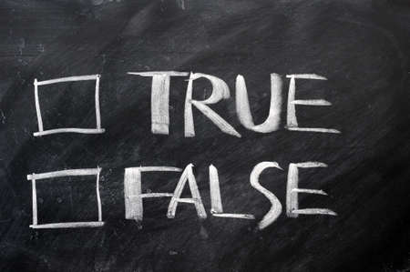 respond: True and false check boxes written with chalk on a blackboard