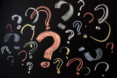 Questions, decision making or uncertainty concept - a pile of colorful question marks drawn on a blackboard Stock Photo - 11690816